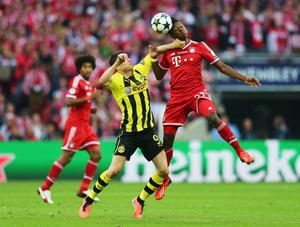 LONDON, ENGLAND - MAY 25:  Robert Lewandowski of Borussia Dortmund (L) in action with David Alaba of Bayern Muenchen during the UEFA Champions League final match between Borussia Dortmund and FC Bayern Muenchen at Wembley Stadium on May 25, 2013 in London, United Kingdom.  (Photo by Alex Grimm/Getty Images)