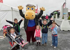 First day of the Balmoral Show in partnership with Ulster Bank at Balmoral Park. Pictured with the Ulster Bank Henri Hippo are the Wilson and George family from Portadown .