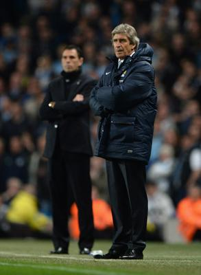 MANCHESTER, ENGLAND - APRIL 16:  Manager Gustavo Poyet of Sunderland and Manuel Pellegrini manager of Manchester City look on during the Barclays Premier League match between Manchester City and Sunderland at Etihad Stadium on April 16, 2014 in Manchester, England.  (Photo by Michael Regan/Getty Images)