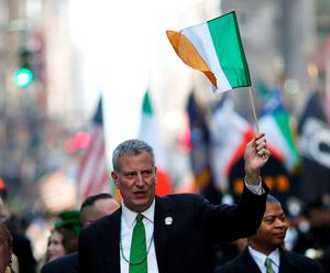 NEW YORK, NY - MARCH 17:  New York City Mayor Bill de Blasio marches in the annual St. Patrick's Day parade, one of the largest and oldest in the world on March 17, 2016 in New York City. Now that a ban on openly gay groups has been dropped, Mayor de Blasio is attending the parade for the first time since he became mayor in 2014. The parade goes up Fifth Avenue ending at East 79th Street and will draw an estimated 2 million spectators along its 35-block stretch.  (Photo by Spencer Platt/Getty Images)