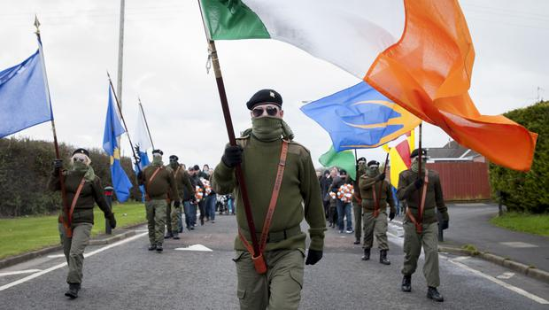 Members of Republican Sinn Fein commemorate the centenary of the Easter Rising. Pictured members of the RSF colour party march through the streets of the Kilwilkee Estate
