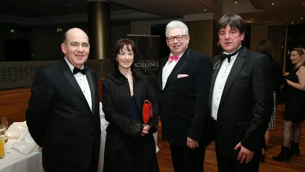 Gerry McGinn, Judena Leslie, Noel Brady and Ger Connery at the Institute of Directors NI Annual Dinner at the Europa Hotel on Thursday night. Sponsored by Bank of Ireland and Arthur Cox, the event is the highlight of the local business calendar and was attended by over 250 people.  Picture by Kelvin Boyes / Press Eye.