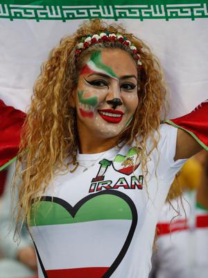 Iranian soccer fan cheers as she waits for the group B match between Iran and Spain at the 2018 soccer World Cup in the Kazan Arena in Kazan, Russia, Wednesday, June 20, 2018. (AP Photo/Frank Augstein)