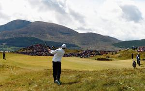NEWCASTLE, NORTHERN IRELAND - MAY 29:  Rory McIlroy of Northern Ireland hits his 2nd shot on the 5th hole during the Second Round of the Dubai Duty Free Irish Open Hosted by the Rory Foundation at Royal County Down Golf Club on May 29, 2015 in Newcastle, Northern Ireland.  (Photo by Ross Kinnaird/Getty Images)