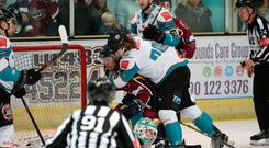 Let's get physical: Belfast Giants and Guildford Flames players clash last night