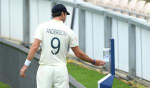 James Anderson made use of a pitch-side hand sanitation point (Stu Forster/Pool)