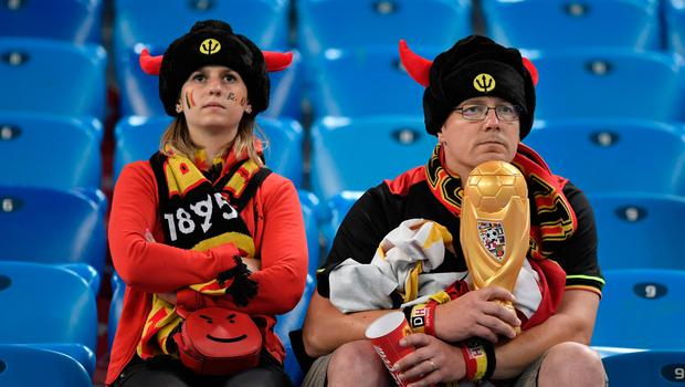 TOPSHOT - Belgium supporters look on at the end of the Russia 2018 World Cup semi-final football match between France and Belgium at the Saint Petersburg Stadium in Saint Petersburg on July 10, 2018. France reached the World Cup final on Tuesday after a second-half header from Samuel Umtiti gave them a 1-0 win against Belgium. / AFP PHOTO / GABRIEL BOUYS / RESTRICTED TO EDITORIAL USE - NO MOBILE PUSH ALERTS/DOWNLOADS GABRIEL BOUYS/AFP/Getty Images