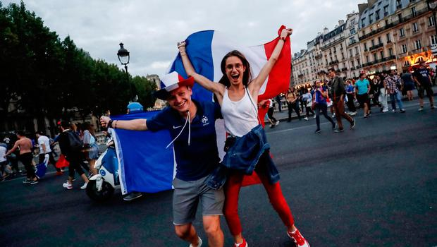 TOPSHOT - People celebrate France's victory in central Paris on July 10, 2018 after the final whistle of the Russia 2018 World Cup semi-final football match between France and Belgium. / AFP PHOTO / Thomas SAMSONTHOMAS SAMSON/AFP/Getty Images
