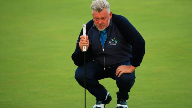 PORTRUSH, NORTHERN IRELAND - JULY 18: Darren Clarke of the Northern Ireland lines up a putt on the second green during the first round of the 148th Open Championship held on the Dunluce Links at Royal Portrush Golf Club on July 18, 2019 in Portrush, United Kingdom. (Photo by Andrew Redington/Getty Images)