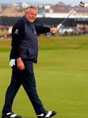 Northern Ireland's Darren Clarke celebrates his birdies on the 1st during day one of The Open Championship 2019 at Royal Portrush Golf Club. PRESS ASSOCIATION Photo. Picture date: Thursday July 18, 2019. See PA story GOLF Open. Photo credit should read: David Davies/PA Wire. RESTRICTIONS: Editorial use only. No commercial use. Still image use only. The Open Championship logo and clear link to The Open website (TheOpen.com) to be included on website publishing.