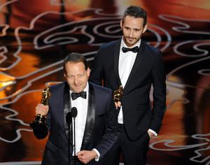 HOLLYWOOD, CA - MARCH 02:  Filmmakers Kim Magnusson (L) and Anders Walter accept the Best Short Film, Live Action award for 'Helium' onstage during the Oscars at the Dolby Theatre on March 2, 2014 in Hollywood, California.  (Photo by Kevin Winter/Getty Images)