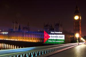 Flag of Palestine projected onto the Houses of Parliament, Westminster, central London. Friday August 1, 2014.