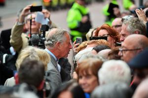 BELFAST, NORTHERN IRELAND - MAY 21:  Prince Charles, Prince of Wales greets well wishers as he visits St Patrick's Church on May 21, 2015 in Belfast, Northern Ireland. Prince Charles, Prince of Wales and Camilla, Duchess of Cornwall will attend a series of engagements in Northern Ireland following their two day visit in the Republic of Ireland.  (Photo by Jeff J Mitchell - WPA Pool/Getty Images)