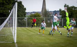SAFE HANDS. .  . .Celtic netminder Joshua Bradley-Hurst comes off his line late in the game to collect this dangerous cross in their 1-0 victory over Donegal Schoolboys at Brooke Park in Tuesday night's Hughes Insurance Foyle Cup clash. FC02-T2-09 (Photos: Jim McCafferty Photography)