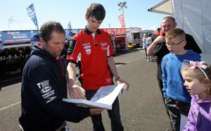 ?Press Eye Ltd Northern Ireland 17th March 2013 - Mandatory Credit - Picture by Matt Mackey/presseye.com  The Vauxhall International 2013 North West 200 road races. Conor Cummins signs autographs in the paddock.