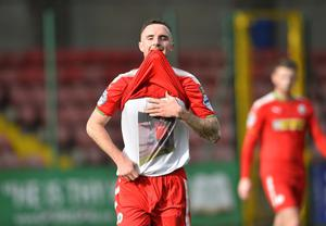 PACEMAKER BELFAST  07/10/2017 Cliftonville v Warrenpoint  Danske Bank Premiership Cliftonville's Jude Winchester celebrates a goal by showing his T-Shirt with a picture of the late Jamesy Morre of Willowbank FC during todays game at Solitude in Belfast. Photo Mark Marlow/Pacemaker Press
