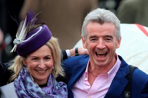Winning owner Michael O'Leary and his wife Anita Farrell celebrate in the winners enclosure after Rivage D'Or wins the Glenfarclas Handicap Chase on Ladies Day during the Cheltenham Festival at Cheltenham Racecourse. PRESS ASSOCIATION Photo. Picture date: Wednesday March 11, 2015. See PA story RACING Cheltenham. Picture credit should read: Nick Potts/PA Wire. RESTRICTIONS: Editorial Use only, commercial use is subject to prior permission from The Jockey Club/Cheltenham Racecourse. Call +44 (0)1158 447447 for further information.