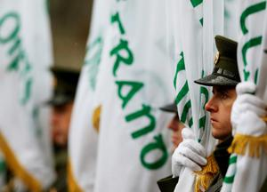 Members of the Irish defence forces during the first major event to mark the centenary of the 1916 Rising, at Dublin Castle in Ireland. PRESS ASSOCIATION Photo. Picture date: Friday January 1, 2016. Three flags which were flown on O'Connell Street during the rebellion were raised over Dublin Castle in the ceremony attended by President Michael D Higgins, Taoiseach Enda Kenny and Tanaiste Joan Burton. See PA story POLITICS Rising Ireland. Photo credit should read: Brian Lawless/PA Wire