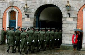 Members of the Irish defence forces leave Dublin Castle after the first major event to mark the centenary of the 1916 Rising took place in Dublin, Ireland. PRESS ASSOCIATION Photo. Picture date: Friday January 1, 2016. Three flags which were flown on O'Connell Street during the rebellion were raised over Dublin Castle in the ceremony attended by President Michael D Higgins, Taoiseach Enda Kenny and Tanaiste Joan Burton. See PA story POLITICS Rising Ireland. Photo credit should read: Brian Lawless/PA Wire