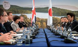 ENNISKILLEN, UNITED KINGDOM - JUNE 17:  Prime Minister David Cameron (3rd L) holds a meeting with the Prime Minister of Japan Shinzo Abe (R) during the first day of the G8 Summit at Lough Erne on June 17, 2013 in Enniskillen, Northern Ireland. The two day G8 summit, hosted by UK Prime Minister David Cameron, is being held in Northern Ireland for the first time. Leaders from the G8 nations have gathered to discuss numerous topics with the situation in Syria expected to dominate the talks.  (Photo by Stefan Rousseau - WPA Pool/Getty Images)