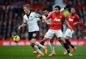 MANCHESTER, ENGLAND - FEBRUARY 09:  Rafael of Manchester United competes with Lewis Holtby (L) and Kieran Richardson of Fulham during the Barclays Premier League match between Manchester United and Fulham at Old Trafford on February 9, 2014 in Manchester, England.  (Photo by Michael Regan/Getty Images)