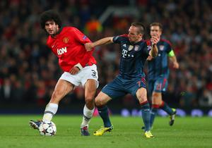 MANCHESTER, ENGLAND - APRIL 01:  Marouane Fellaini of Manchester United and Franck Ribery of Bayern Muenchen battle for the ball during the UEFA Champions League Quarter Final first leg match between Manchester United and FC Bayern Muenchen at Old Trafford on April 1, 2014 in Manchester, England.  (Photo by Alex Livesey/Getty Images)