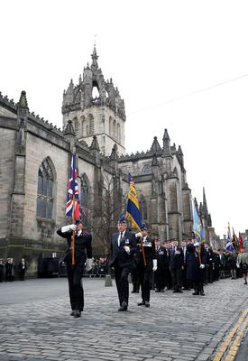 Veterans parade past St Giles' Cathedral, Edinburgh, during a Remembrance Sunday parade held in tribute for members of the armed forces who have died in major conflicts. Danny Lawson/PA Wire.