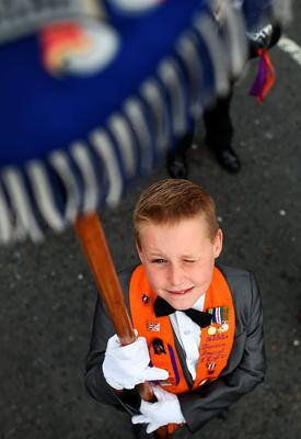A young band member poses for a photograph as thousands of Orangemen and bandsmen take part in the annual Orange march on July 12, 2016 in Belfast, Northern Ireland. The Orange marches and demonstrations celebrate the Battle of the Boyne in 1690 when the Protestant King William of Orange defeated the Catholic King James II on the banks of the river Boyne. (Photo by Charles McQuillan/Getty Images)