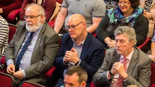 Sinn Fein members (left to right), Francie Molloy, Paul Maskey and Mickey Brady MP, attend Labour leader Jeremy Corbyn's lecture at Queens University in Belfast. PRESS ASSOCIATION Photo. Picture date: Thursday May 24, 2018. Mr Corbyn urged Prime Minister Theresa May to reconvene the British Irish Intergovernmental Conference - a body that offers the Irish a consultative role in non-devolved matters concerning Northern Ireland. See PA story ULSTER Corbyn. Photo credit should read: Liam McBurney/PA Wire