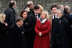 LONDONDERRY, NORTHERN IRELAND - MARCH 23:  (L-R) Sinn Fein Southern leader Mary Lou McDonald, Northern Ireland Leader, Michelle O'Neill and Sinn Fein President Gerry Adams arrive at St Columba's Church on March 23, 2017 in Londonderry, Northern Ireland. The funeral is held for Northern Ireland's former Deputy First Minister Martin McGuinness who died on Monday 20th March 2017. He was once chief of staff of the IRA but later became Sinn Fein's chief negotiator in the talks that led to the Good Friday agreement bringing peace to Northern Ireland.  (Photo by Dan Kitwood/Getty Images)