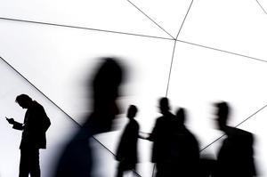 Visitors walk past a Samsung stand during the first day of the Mobile World Congress 2014 at the Fira Gran Via complex on February 24, 2014 in Barcelona, Spain.