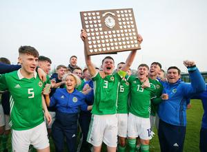 Paddy Burns celebrates leading Northern Ireland to Centenary Shield success last year.