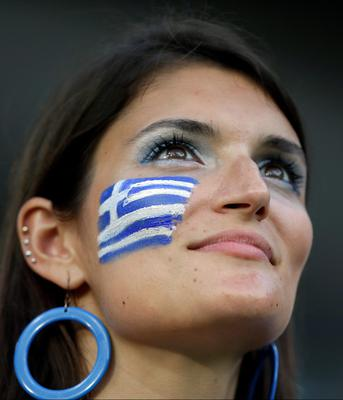 A Greek supporter waits for the start of the World Cup round of 16 soccer match between Costa Rica and Greece at the Arena Pernambuco in Recife, Brazil, Sunday, June 29, 2014. (AP Photo/Andrew Medichini)
