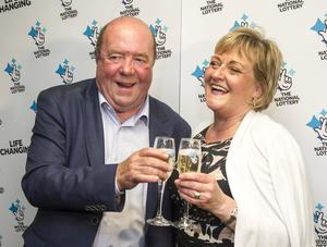 Eithne and Colin Bell, who founded the Kevin Bell Repatriation Trust, collecting their  £1,000,000 in Newry. [Photo: Newraypics.com]