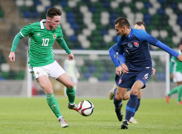 Press Eye - Belfast - Northern Ireland - 16th October 2018  European U21 Championship 2019 Qualifying Round at the National Stadium art Windsor Park.  Northern Ireland Vs Slovakia.   Northern Ireland's Jordan Thompson with Slovakia's Martin Sulek.  Picture by Jonathan Porter/PressEye