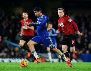 Chelsea's Brazilian-born Spanish striker Diego Costa runs with the ball during the English Premier League football match between Chelsea and West Bromwich Albion at Stamford Bridge in London on January 13, 2016. The game finished 2-2. AFP PHOTO / BEN STANSALL  RESTRICTED TO EDITORIAL USE. NO USE WITH UNAUTHORIZED AUDIO, VIDEO, DATA, FIXTURE LISTS, CLUB/LEAGUE LOGOS OR 'LIVE' SERVICES. ONLINE IN-MATCH USE LIMITED TO 75 IMAGES, NO VIDEO EMULATION. NO USE IN BETTING, GAMES OR SINGLE CLUB/LEAGUE/PLAYER PUBLICATIONS.BEN STANSALL/AFP/Getty Images