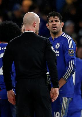 Chelsea's Brazilian-born Spanish striker Diego Costa has words with referee Anthony Taylor after the English Premier League football match between Chelsea and West Bromwich Albion at Stamford Bridge in London on January 13, 2016. The game finished 2-2. AFP PHOTO / IAN KINGTON  RESTRICTED TO EDITORIAL USE. NO USE WITH UNAUTHORIZED AUDIO, VIDEO, DATA, FIXTURE LISTS, CLUB/LEAGUE LOGOS OR 'LIVE' SERVICES. ONLINE IN-MATCH USE LIMITED TO 75 IMAGES, NO VIDEO EMULATION. NO USE IN BETTING, GAMES OR SINGLE CLUB/LEAGUE/PLAYER PUBLICATIONS.IAN KINGTON/AFP/Getty Images