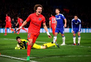 LONDON, ENGLAND - MARCH 11:  David Luiz of PSG celebrates after teammate Thiago Silva of PSG scores a goal to level the scores at 2-2 during the UEFA Champions League Round of 16, second leg match between Chelsea and Paris Saint-Germain at Stamford Bridge on March 11, 2015 in London, England.  (Photo by Paul Gilham/Getty Images)