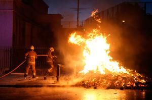 Firefighters near a lit bonfire on Albertbridge Road, Belfast ahead of the key date in the protestant loyal order marching season - the Twelfth of July. PRESS ASSOCIATION Photo. Picture date: Tuesday July 11, 2017.