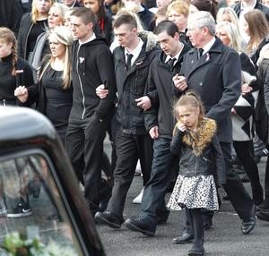 Funeral of Derry family who drowned in Buncrana Co-Donegal pier accident. 24-3-16 The funeral for five members of the McGrotty/Daniels family taking place at Holy Family Church in Derry city on Thursday. Louise James lost her partner Sean McGrotty, sons Mark and Evan, sister Jodie-Lee Daniels and mother Ruth Daniels. The jeep the victims were in slipped off the pier at Buncrana in Co-Donegal on Sunday night. A four month old baby girl was rescued from the vehicle. Picture Margaret McLaughlin © please by-line 24-3-16 see story