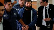 Israeli Yosef Haim Ben-David (C), the ringleader of the killing of Palestinian teenager Mohammed Abu Khdeir last year, is escorted by Israeli policemen at the district court in Jerusalem on April 19, 2016. AFP/Getty Images