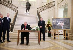 Press Eye - Belfast - Northern Ireland - 15th September 2014 - Picture by Kelvin Boyes / Press Eye.  Deputy First Minister Martin McGuinness signs a book of condolence at in the Great Hall at Parliament Buildings, Stormont, Belfast, in memory of former DUP leader and First Minister Rev Ian Paisley.   The funeral of Ian Paisley, the former Democratic Unionist Party leader and first minister of Northern Ireland, will take place this week.