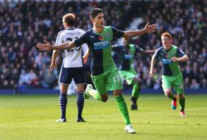 Newcastle United's Ayoze Perez celebrates scoring their first goal during the Barclays Premier League match at the Hawthorns, West Bromwich. David Davies/PA Wire.