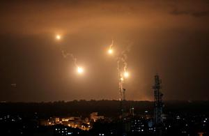 Israeli forces flares light up the night sky in the east of Gaza City on Monday, July 28, 2014. (AP Photo/Khalil Hamra)