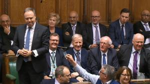 An MP waved a credit card at Mr Dodds during his remarks.