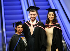 Graduating from Ulster University with a BA Hons degree in Fine Art, Natasha Crummy from Newry, BA Hons Textiles Design & Fashion Ryan Kearney from Newry and Raychel Murphy, BA Hons Textiles Design & Fashion from Donegal. Pic By Paul Moane