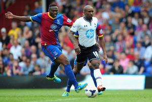 LONDON, ENGLAND - AUGUST 18:  Jermain Defoe of Tottenham Hotspur is closed down by Kagisho Dikgacoi of Crystal Palace during the Barclays Premier League match between Crystal Palace and Tottenham Hotspur at Selhurst Park on Augsut 18, 2013 in London, England.  (Photo by Jamie McDonald/Getty Images)