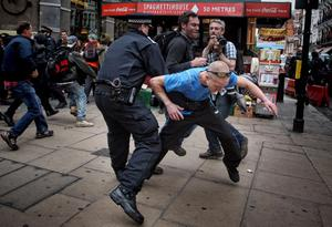 Protesters clash with police in Golden Square, London. PRESS ASSOCIATION Photo. Picture date: Tuesday June 11, 2013. Hundreds of riot police were deployed throughout central London today as protests took place against next week's G8 summit. A building was occupied by demonstrators in Soho and there was a stand-off between protesters and police in Piccadilly as officers blocked access to Fortnum & Mason. The historic shop was targeted during protests against Government cuts in 2011. See PA story POLICE G8. Photo credit should read: Lewis Whyld/PA Wire
