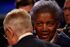 Democratic National Committee (DNC) Chair Donna Brazile (R) confers with US Senate Minority Leader Harry Reid (L), D-Nevada, prior to the third and final US presidential debate between Democratic nominee Hillary Clinton and Republican nominee Donald Trump at the Thomas & Mack Center on the campus of the University of Las Vegas in Las Vegas, Nevada on October 19, 2016. / AFP PHOTO / Paul J. RichardsPAUL J. RICHARDS/AFP/Getty Images