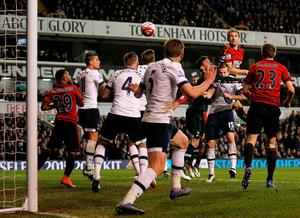 West Bromwich Albion's English defender Craig Dawson (Top R) scores his team's first goal during the English Premier League football match between Tottenham Hotspur and West Bromwich Albion at White Hart Lane in London, on April 25, 2016. / AFP PHOTO / IKIMAGES / IKimages / RESTRICTED TO EDITORIAL USE. No use with unauthorized audio, video, data, fixture lists, club/league logos or 'live' services. Online in-match use limited to 45 images, no video emulation. No use in betting, games or single club/league/player publications.IKIMAGES/AFP/Getty Images